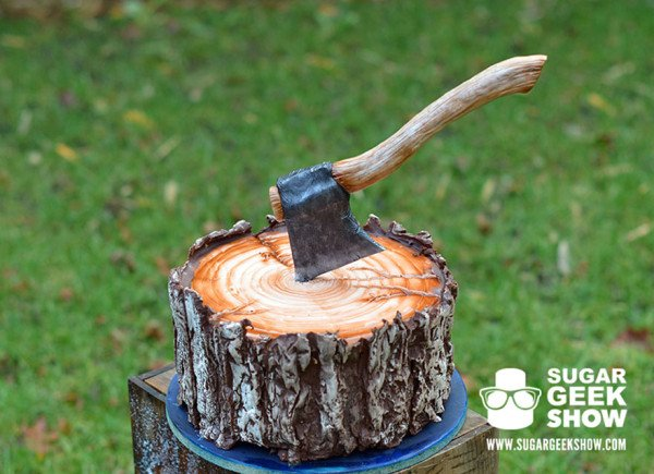A Lumberjack Cake With An Edible Axe And A Plaid Pattern Inside